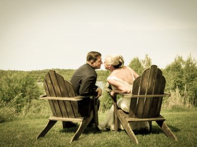 newly weds sitting in chair at Grand Ely lodge