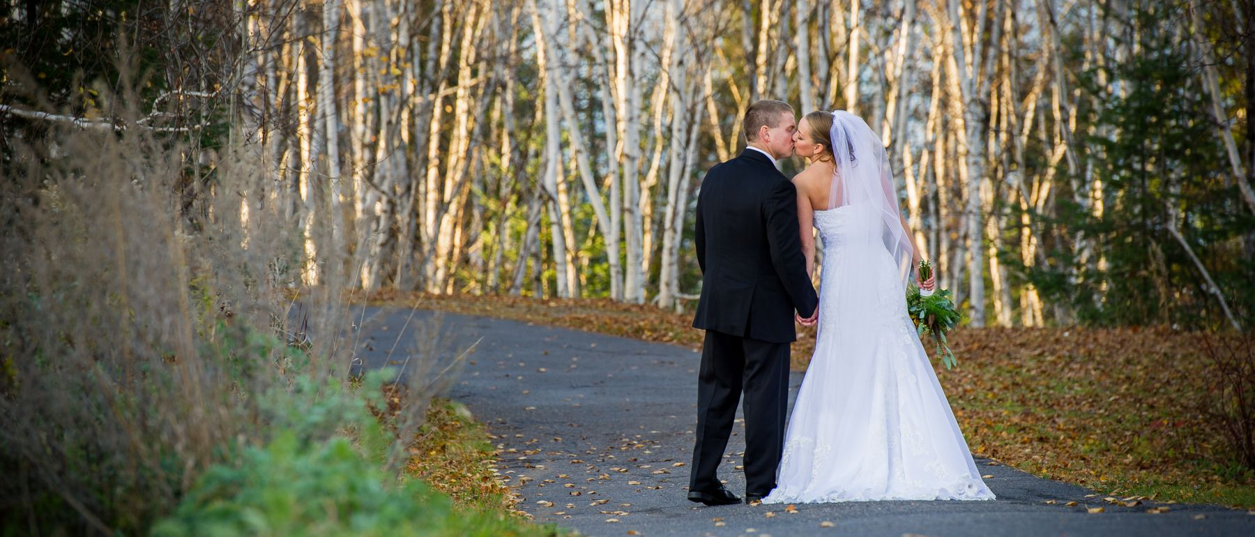 newly weds walking down to marina at Grand Ely Lodge resort