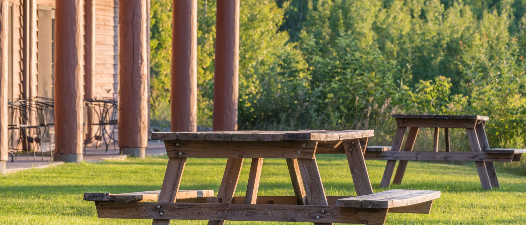 picnic tables outside of Grand Ely Lodge