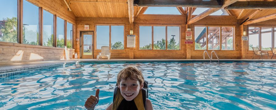 Child Enjoying the Large Indoor Pool at Grand Ely Lodge