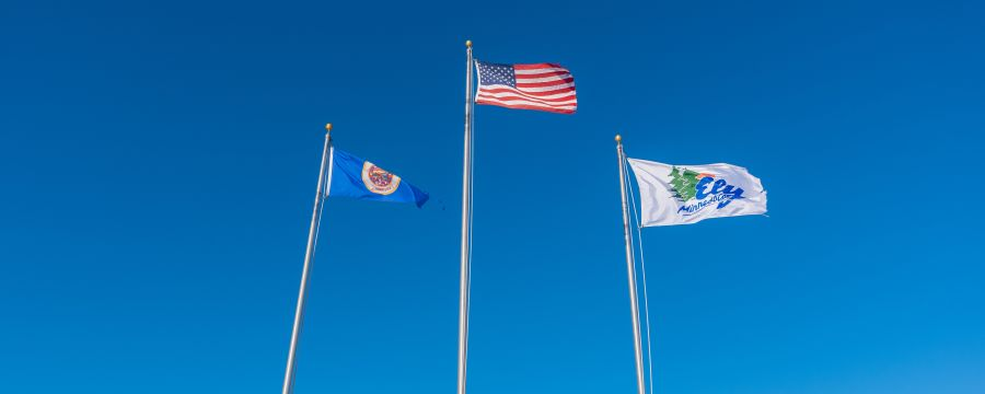 Flags at the entrance of Grand Ely Lodge