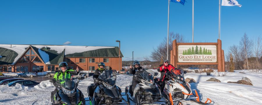 snowmobiles outside of Grand Ely Lodge